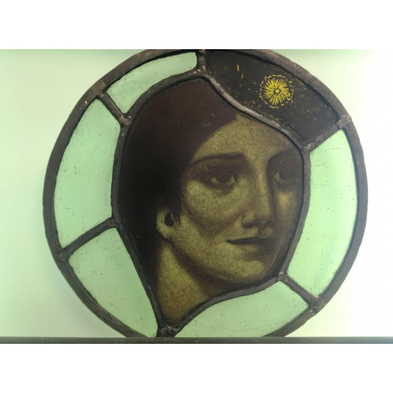Painted stained glass roundel of womans head