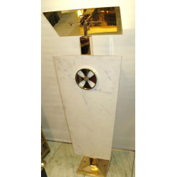 Brass and marble lectern under lights (lit up)