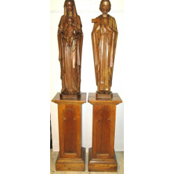 Wooden holy family statues on pedestals