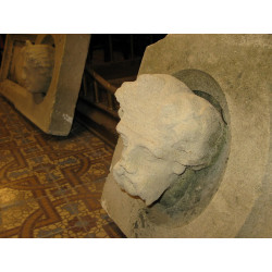 A pair of sandstone heads